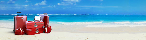 White sand beach with clear blue water.