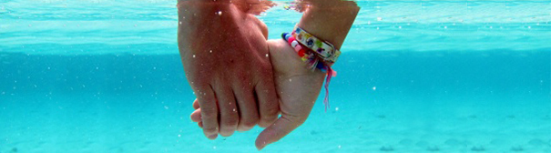 Photo of hands holding underwater