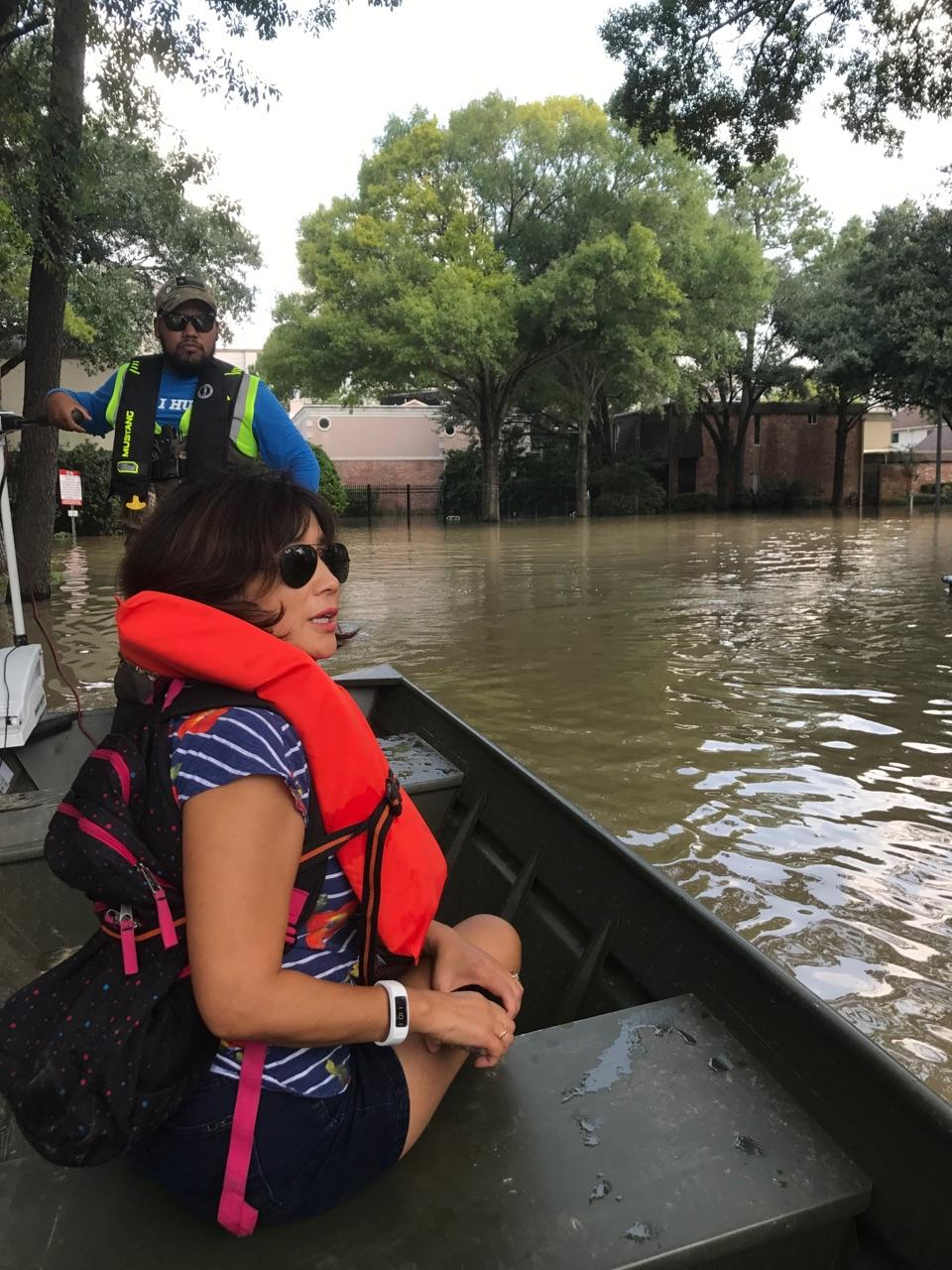 West Houston homeowner Mary Sit surveys flooding in her neighborhood caused by a release of dam water several days after Hurricane Harvey made landfall. Photo credit goes to Amy Sit Duvall