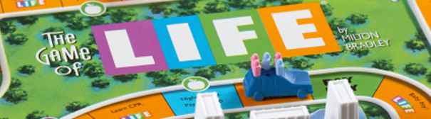 Pieces and the board of The Game of Life, a popular boardgame.