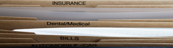 Photo: Folders of insurance, medical, and bills