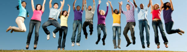 Group of young adults jumping
