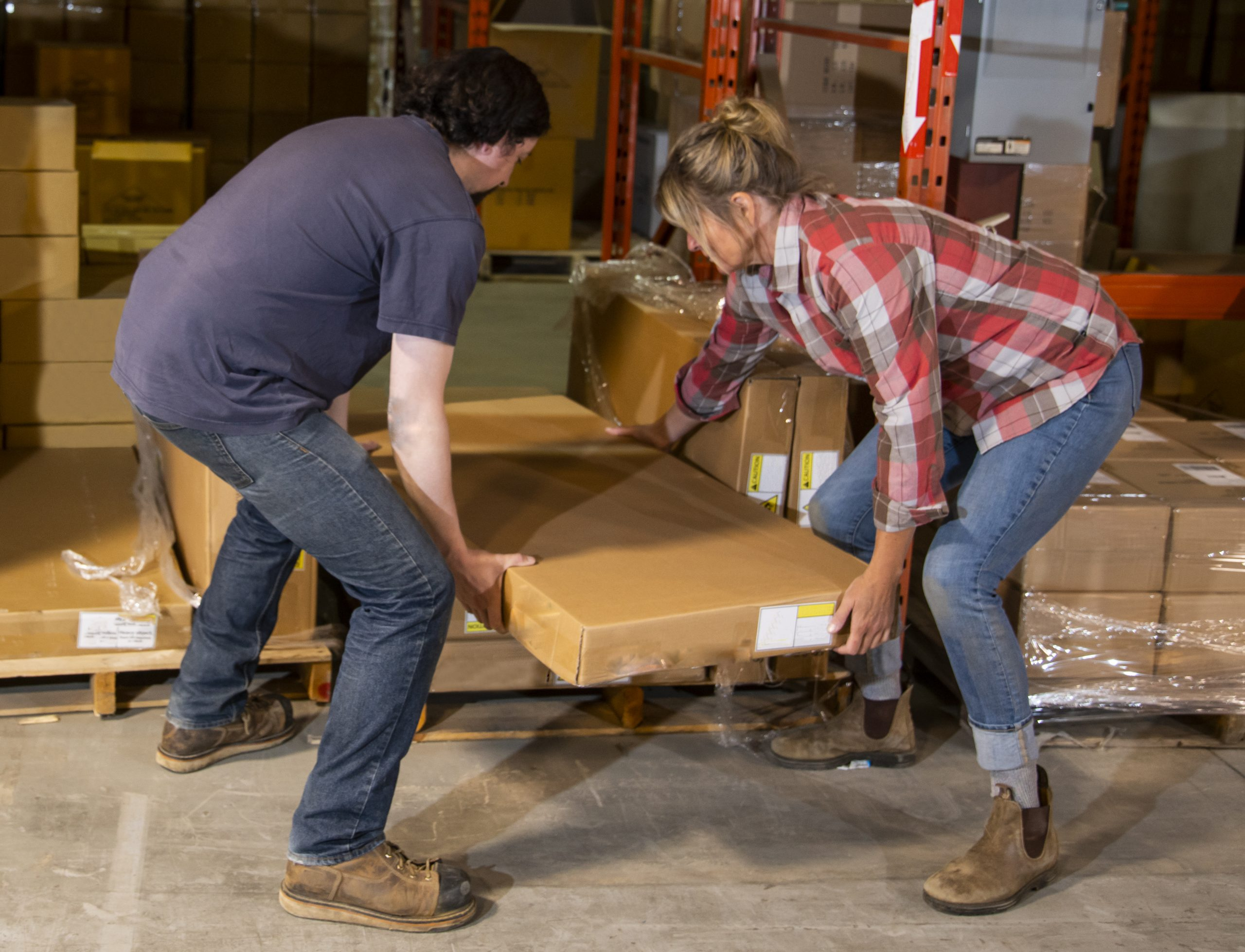 People lifting a heavy box