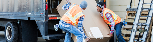 Two workers loading a truck